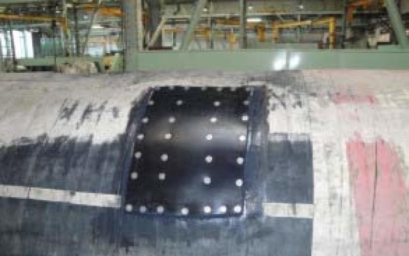 Rubber mat bonded over the damaged area with Belzona 2211 (MP Hi-Build Elastomer)