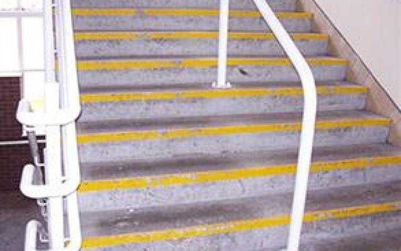 Damaged and worn steps creating slip hazard