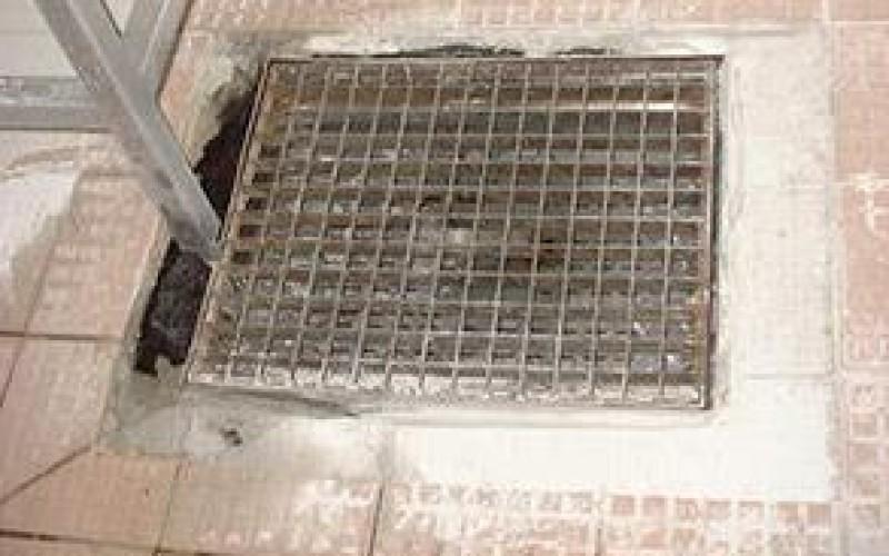 Damaged tiles on kitchen floor
