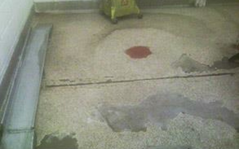 Deteriorated kitchen washroom floor from constant contact with cleaning agents