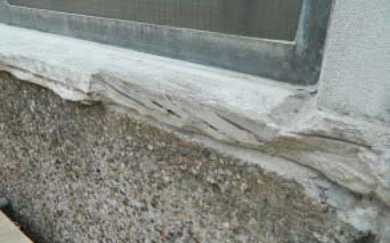 Spalled concrete window sill