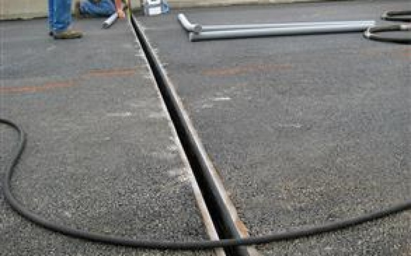 Damaged expansion joint on road section