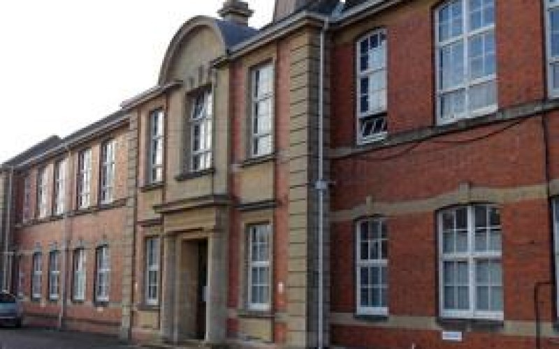 School building suffering from water ingress and dirt on the brickwork