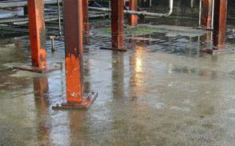 Damaged concrete secondary containment area