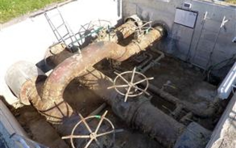 General view of corroded pipework in the access chamber of a district heating facility