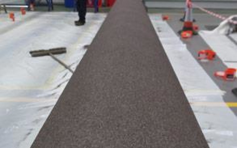 Belzona 5892 blinded with Belzona 9211 aggregate to eliminate further blasting