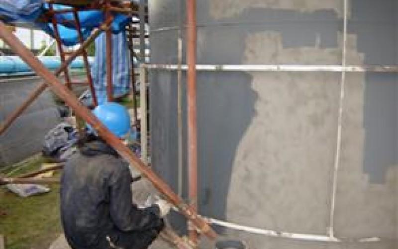 Tank being coated using Belzona 6111 (Liquid Anode)