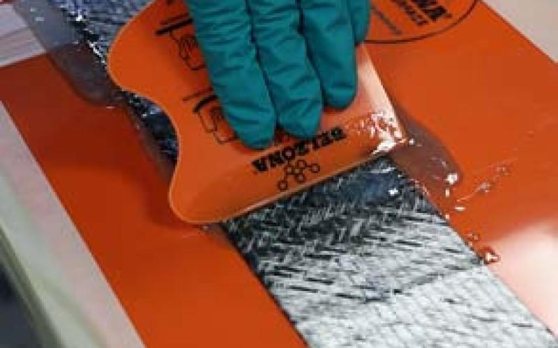 Wetting out the reinforcement sheet using the Belzona SuperWrap II fluid grade resin